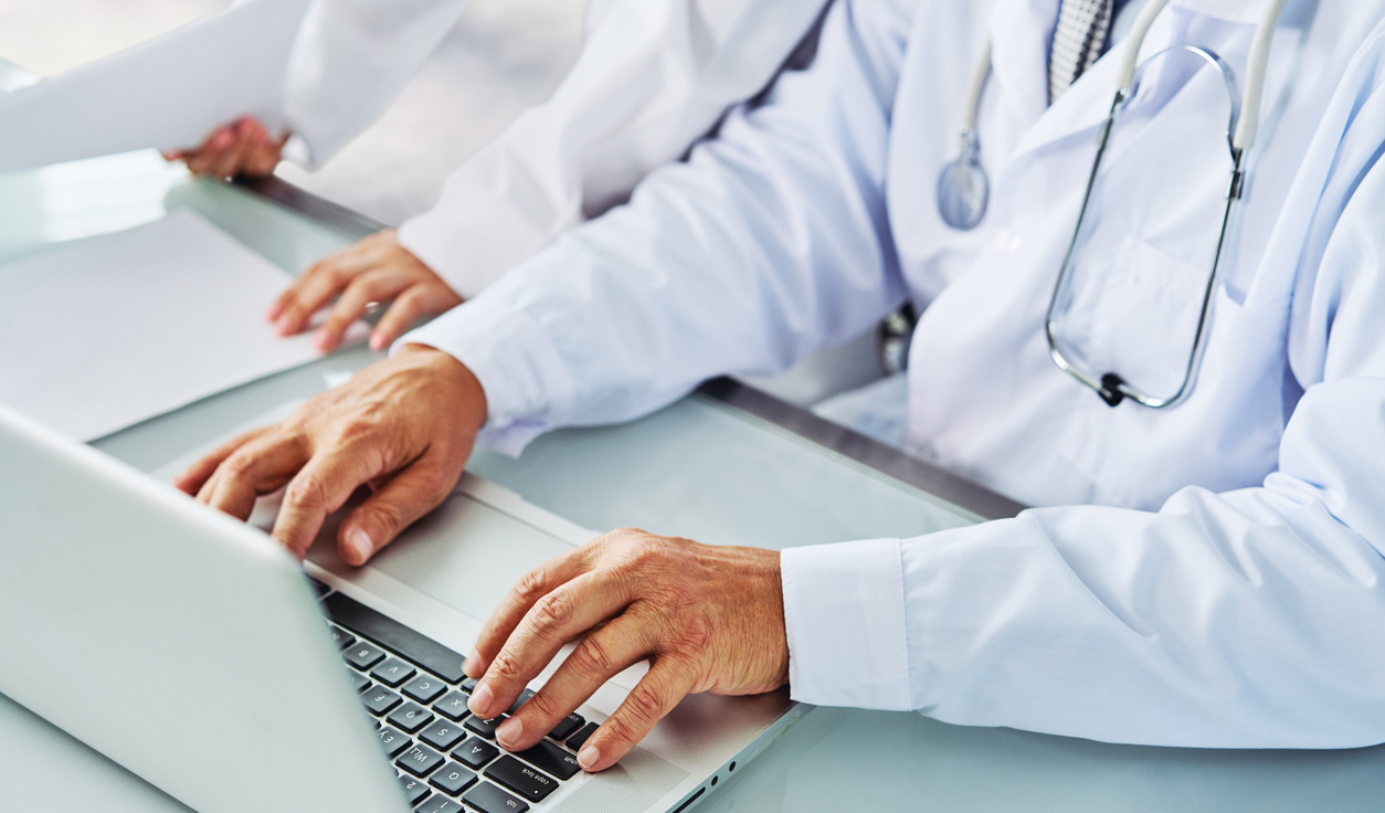 Physician working on computer